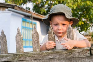 attachment strategies boy at fence