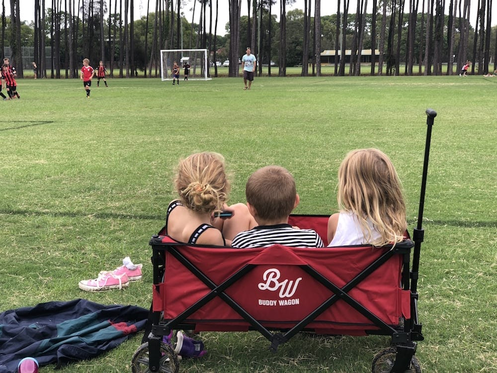 Young kids sitting in Buddy Wagon