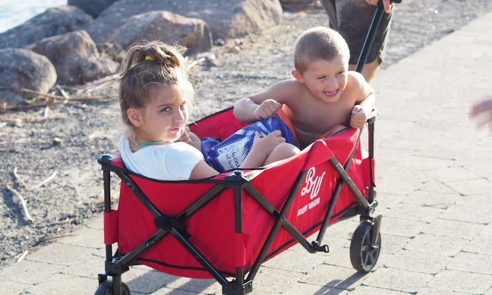 Smiling kids in Buddy Wagon