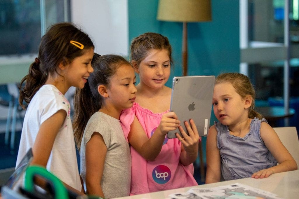 qut school holiday activities girls with ipad