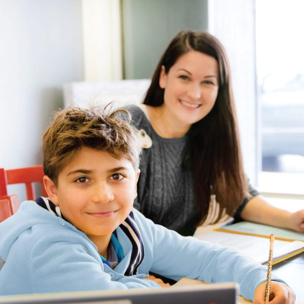 Smiling student and teacher