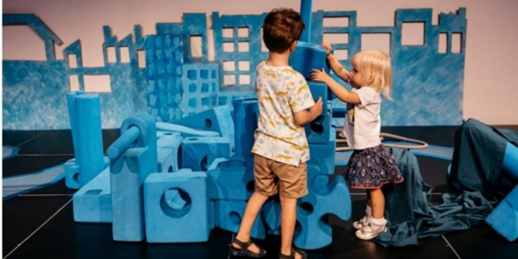 Toddlers playing with building blocks at The State Library of Queensland