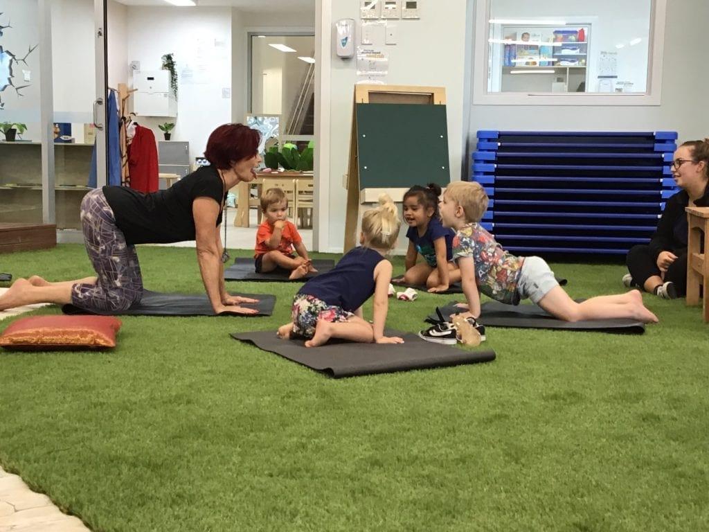 children enjoying yoga at Bowen Hills Early Learning