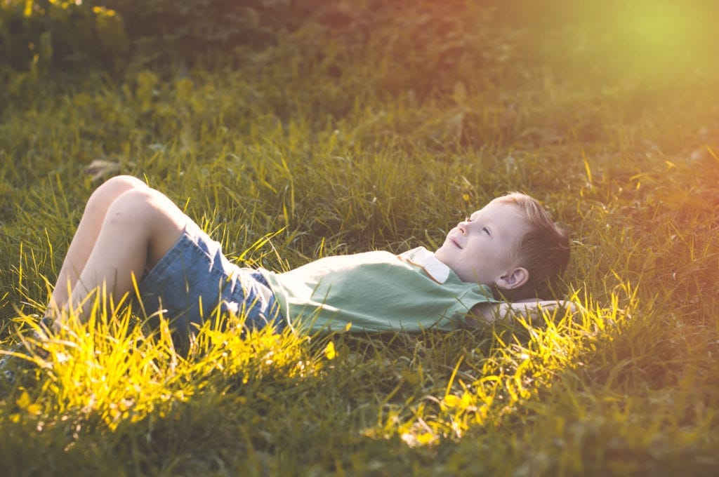 Child relaxing in grass