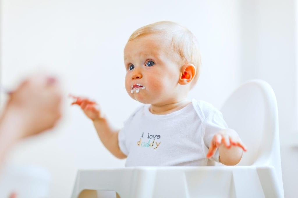 Baby enjoying solid food