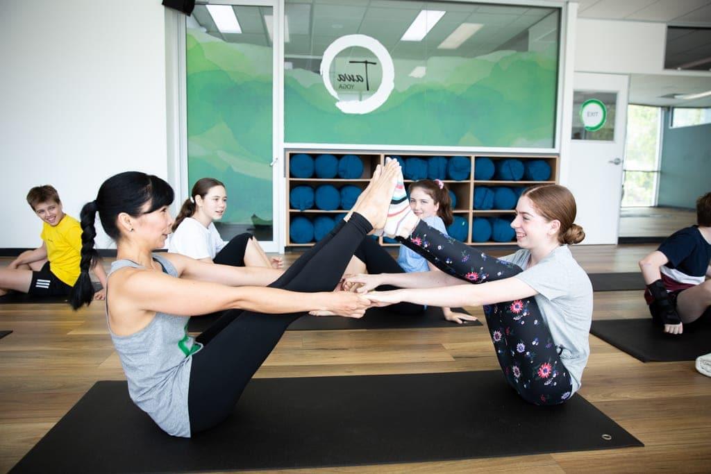 Teens improving flexibility through yoga