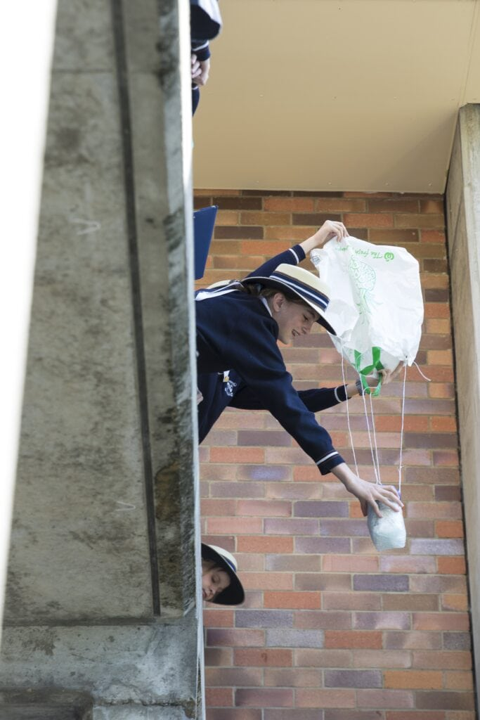 A St Margaret's Year 7 student about to test her egg drop contraption