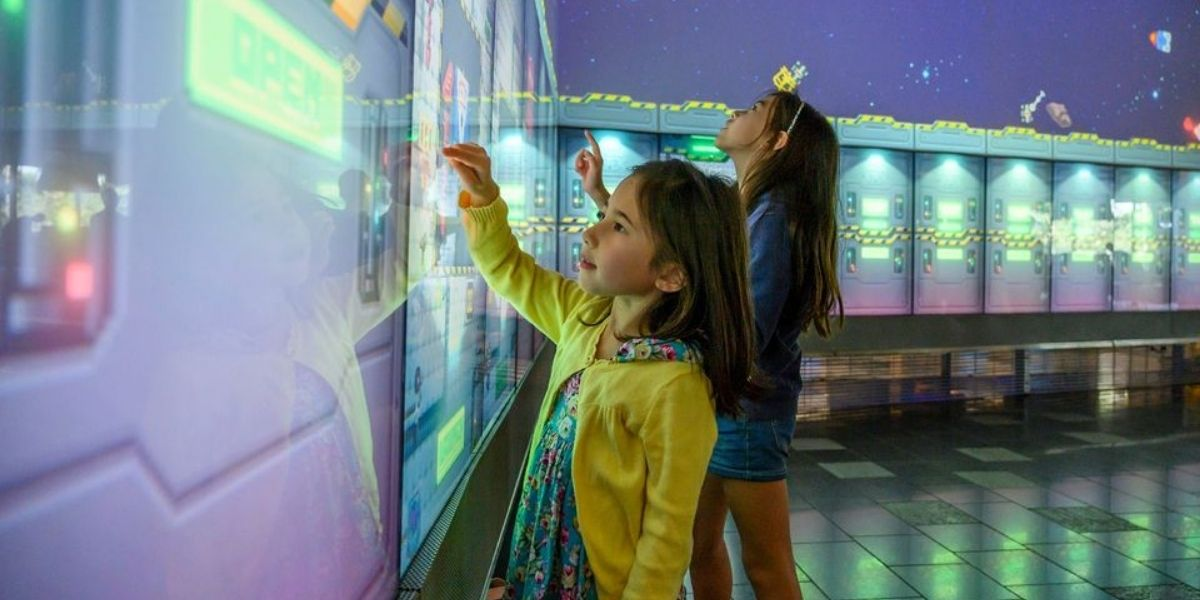 child interacting with screen at QUT's The Cube