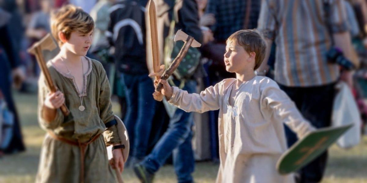 Boys role play as vikings