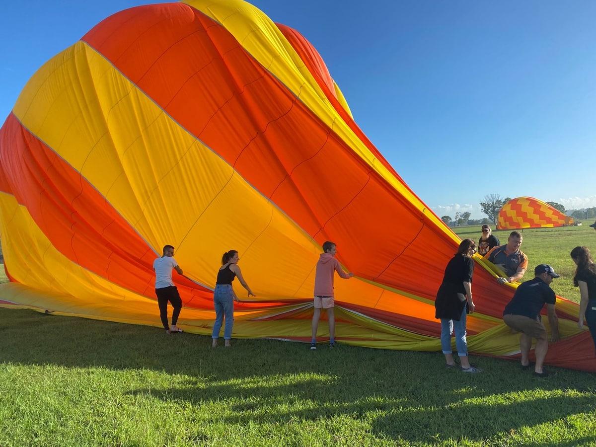 hot air balloon Brisbane - packing up the balloon